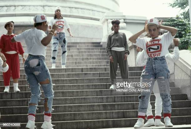 American hip-hop trio Salt-N-Pepa and friends dancing on the steps of the Soldiers' and Sailors' Monument, during the video shoot for their single,...