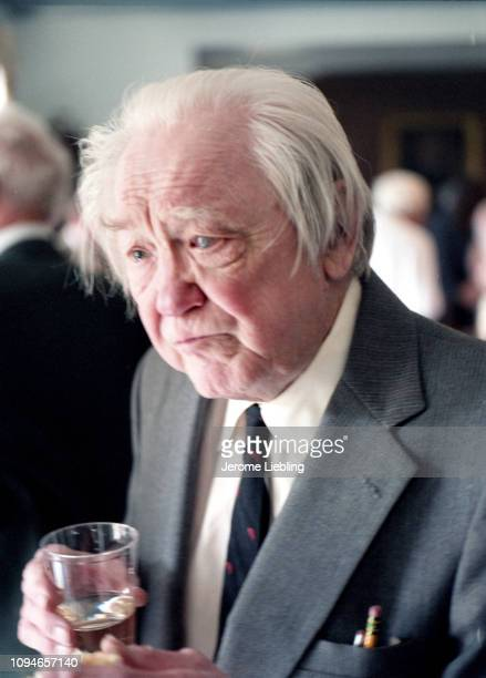 American historian and author Henry Steele Commager as he stands amidst unidentified guests at a social gathering Amherst Massachusetts May 1986 He...
