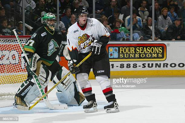 American hockey player Bobby Ryan of the Owen Sound Attack watches the action from in front of the net whcih is guarded by goalie Gerald Coleman of...