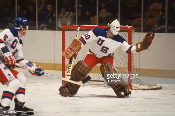 American hockey player Jim Craig goalkeeper for Team USA makes a save in an exhibition game against the Soviet team at Madison Square Garden New York...