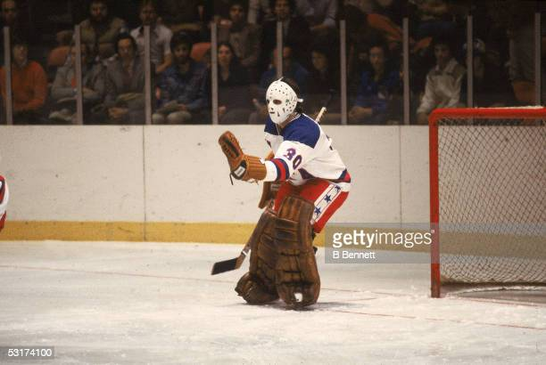 American hockey player Jim Craig goalkeeper for Team USA stick out his glove to make a save in an exhibition game against the Soviet team at Madison...