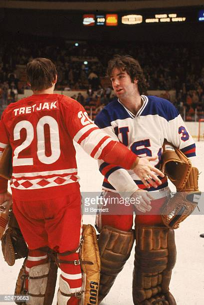 American hockey player Jim Craig shakes hands with fellow goalie CCCP player Vladislav Tretiak after the Soviet team beat Team USA in an exhibition...