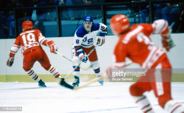 American hockey player Mark Pavelich of Team USA battles with Helmuts Balderis of the USSR during the 1980 exhibition game against the Soviet Union...