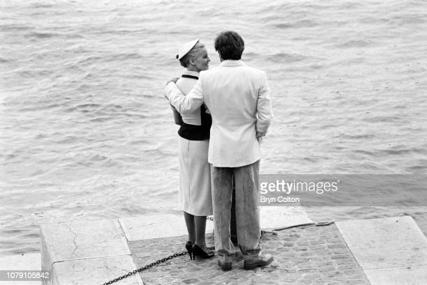 American Hollywood actress Cheryl Ladd playing Grace Kelly and actor Alejandro Rey playing Oleg Cassini stand on the quayside in France as they film...