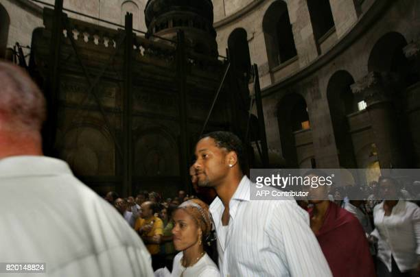 American Hollywood star Will Smith with his wife Jada Pinkett Smith leave the Church of the Holy Sepulchre following a visit in Jerusalem's Old City...