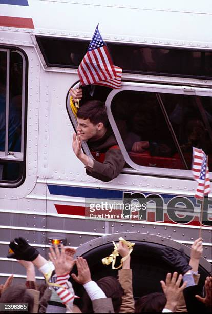 American hostages on a bus returning to the US following their captivity in Iran ride down Pennsylvania Avenue January 1981 in Washington DC The...