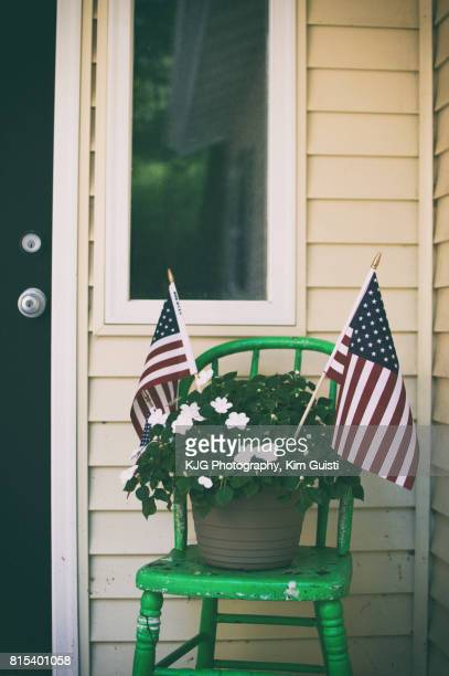 American House with Flowers and USA Flags