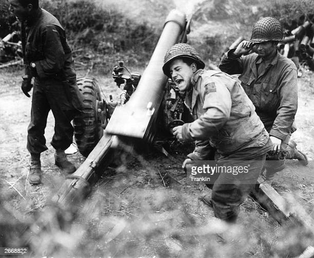 American howitzers shell German forces retreating near Carentan