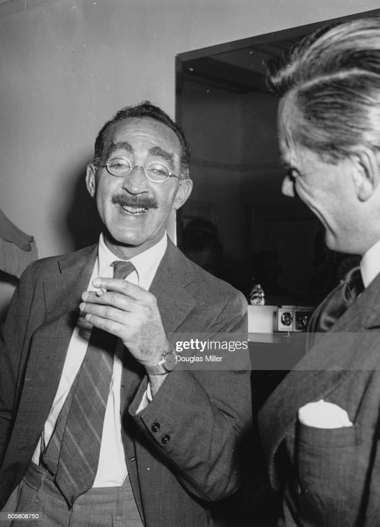 American humorist and screen writer S J Perelman (left), adaptor of Jules Verne's 'Around the World in 80 Days' for the cinema, at a press conference at Brown's Hotel, London, August 15th 1955.