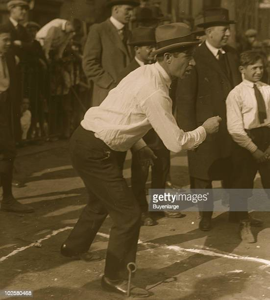 American humorist Will Rogers plays a game of horseshoes 1924
