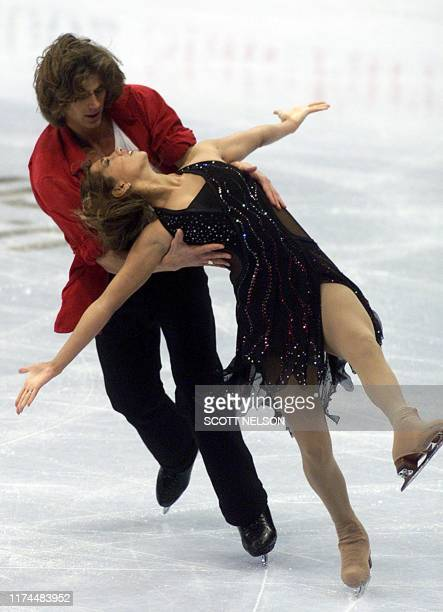 American ice dancer Peter Tchernyshev cradles his partner Naomi Lang during the 12 January 2002 Free Dance portion of the State Farm US Figure...
