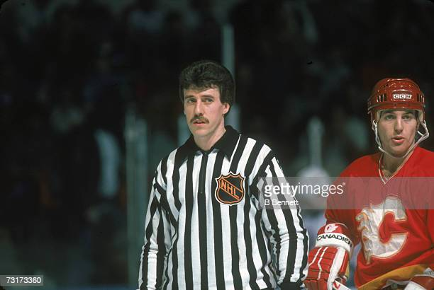 American ice hockey linesman Pat Dapuzzo on the ice during a game involving the Calgary Flames March 1986