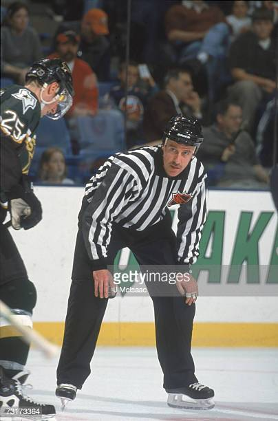 American ice hockey linesman Pat Dapuzzo prepares to drop the puck during a game involving the Dallas Stars October 2001