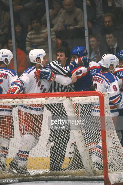 American ice hockey linesman Pat Dapuzzo shouts in the midst of a fight between Tom Laidlaw of the New York Rangers and Robert Picard during a game...
