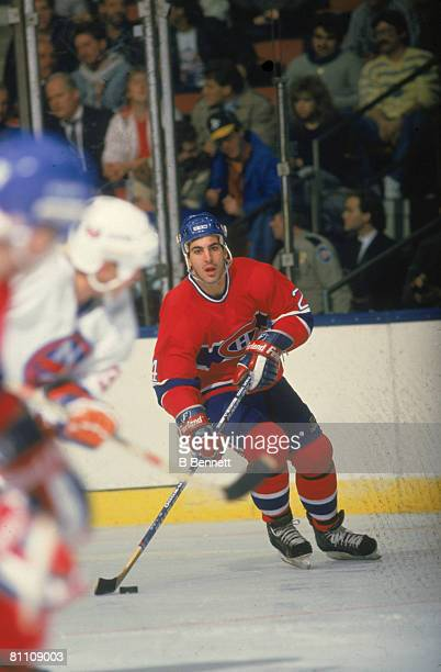 American ice hockey player Chris Chelios of the Montreal Canadiens skates with the puck during a game 1980s