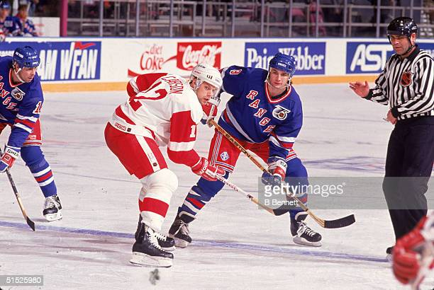 American ice hockey player Jimmy Carson #12 for the Detroit Red Wings faces off against Darren Turcotte #8 for the New York Rangers in a game at...