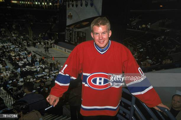 American ice hockey player Mike Komisarek wears a Montreal Canadiens jersey after he was selected as their first round pick in the NHL Entry Draft...