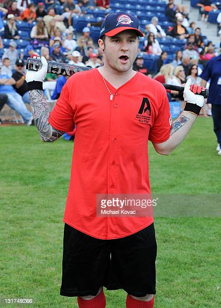 American Idol Blake Lewis warms up during Steve Garvey's Celebrity Softball Game for ALS at Pepperdine University on July 10 2010 in Malibu California