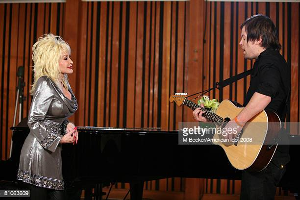 American Idol contestant David Cook rehearses in the studio with country singer Dolly Parton on March 29 2008 in Los Angeles California