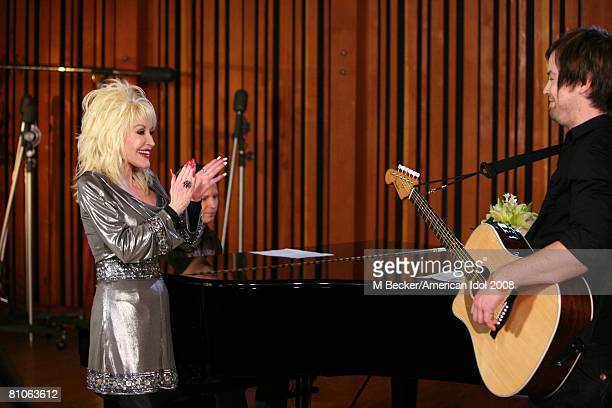 American Idol contestant David Cook rehearses in the studio with country singer Dolly Parton on March 29, 2008 in Los Angeles, California.