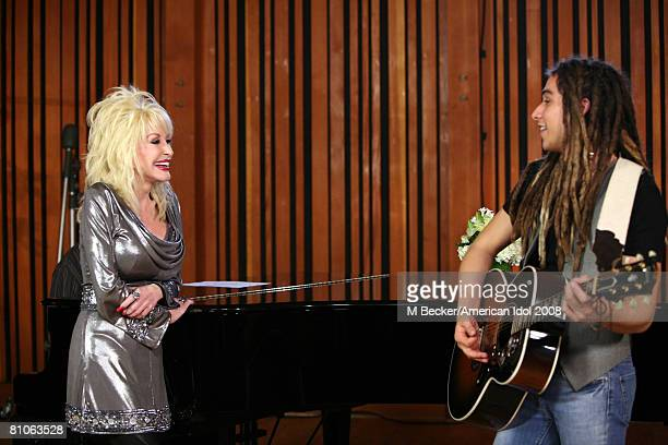 American Idol contestant Jason Castro rehearses in the studio with country singer Dolly Parton on March 29, 2008 in Los Angeles, California.