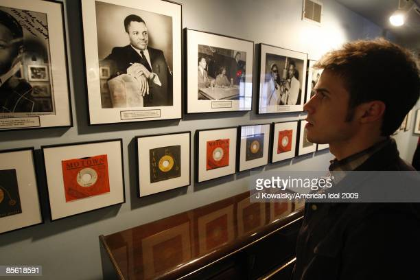 American Idol contestant Kris Allen gets a close up look of old motown photographs during a tour of the the Motown Museum with Motown founder Barry...