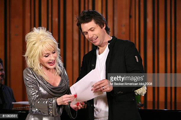 American Idol contestant Michael Johns rehearses in the studio with country singer Dolly Parton on March 29, 2008 in Los Angeles, California.