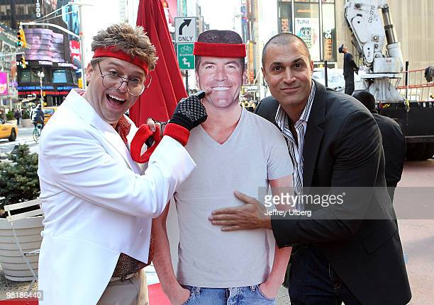 American Idol Contestant Norman Gentle aka Nick Mitchell and Nigel Barker shoot the Brit Slap music video in Times Square on April 1 2010 in New York...