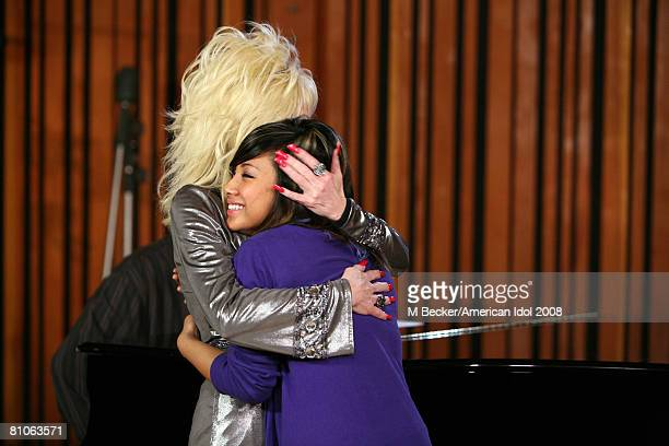 American Idol contestant Ramiele Malubay rehearses in the studio with country singer Dolly Parton on March 29, 2008 in Los Angeles, California.