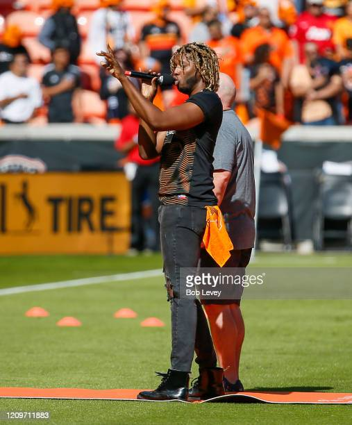American Idol contestant Uche performs the national anthem before the Los Angeles Galaxy play the Houston Dynamo at BBVA Stadium on February 29 2020...