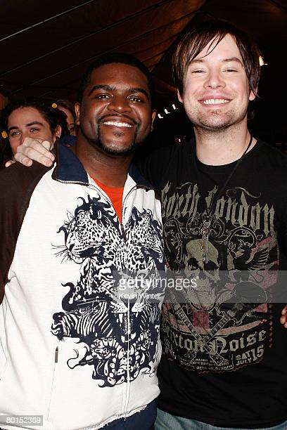 American Idol contestants Chikezie and David Cook attend the American Idol Top 12 Party at the Pacific Design Center on March 6 2008 in West...