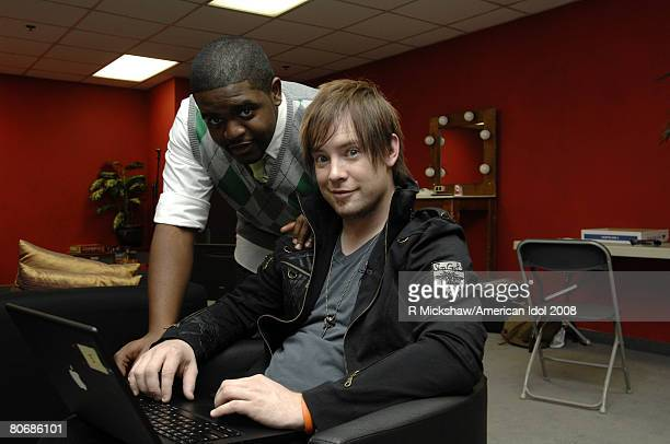 ACCESS*** American Idol Contestants Chikezie Eze and David Cook poses for pictures behind the scenes on March 11 2008 in Los Angeles California...