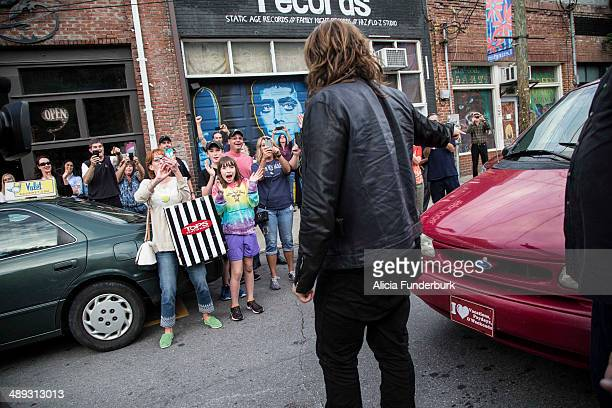 """American Idol"""" finalist Caleb Johnson greets fans outside of The Emerald Lounge during his homecoming on May 10, 2014 in Asheville, North Carolina."""