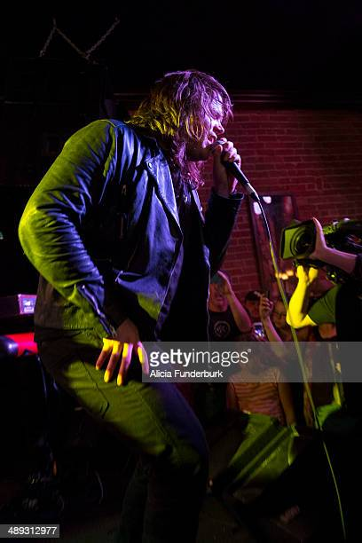 """American Idol"""" finalist Caleb Johnson performs at The Emerald Lounge during his homecoming on May 10, 2014 in Asheville, North Carolina."""