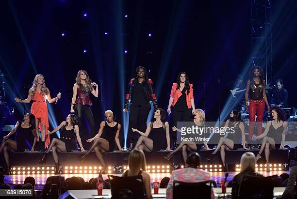 American Idol finalists Janelle Arthur Angie Miller Candice Glover Kree Harrison and Amber Holcomb perform onstage during Fox's American Idol 2013...