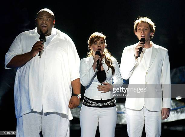 American Idol finalists Ruben Studdard and Clay Aiken perform a song with last year's winner Kelly Clarkson during the show's grand finale on May 21...