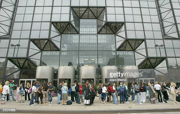 American Idol hopefuls wait on line outside the Jacob Javits Center to audition for the third season August 25, 2003 in New York City.