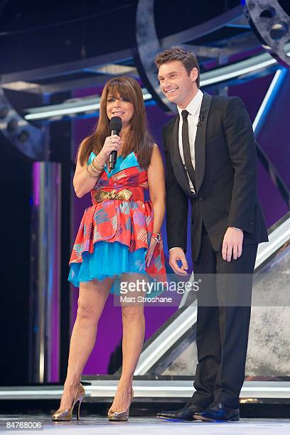 American Idol judge Paula Abdul and host Ryan Seacrest walk onstage during the grand opening show of the American Idol Experience at Disney's...
