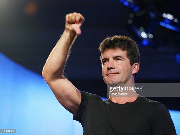 American Idol judge Simon Cowell demonstrates his style for the press at the FOX 2002 SummerTCA Tour at the Huntington Ritz Carlton Hotel in Pasadena...