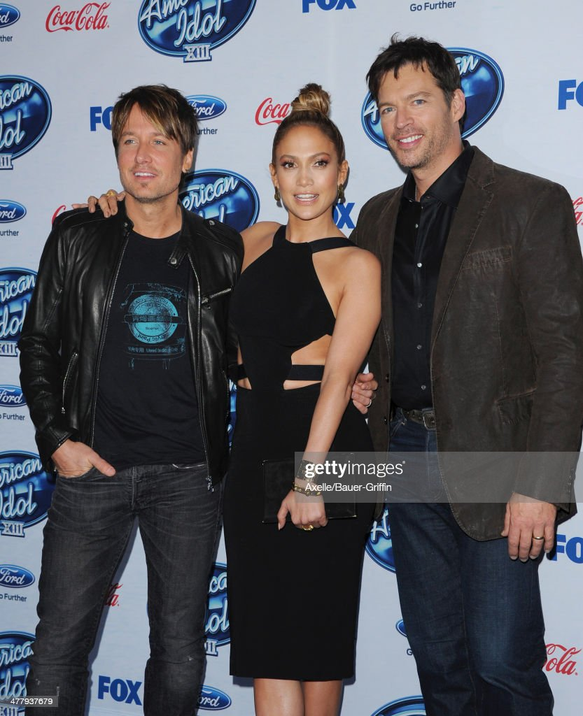 'American Idol' judges musician Keith Urban, actress/singer Jennifer Lopez and musician Harry Connick Jr. arrive at Fox's 'American Idol XIII' finalists party held at Fig & Olive Melrose Place on February 20, 2014 in West Hollywood, California.
