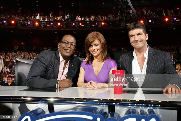 American Idol judges Randy Jackson Paula Abdul and Simon Cowell are seated infront of the stage at the American Idol Finale Results Show held at the...
