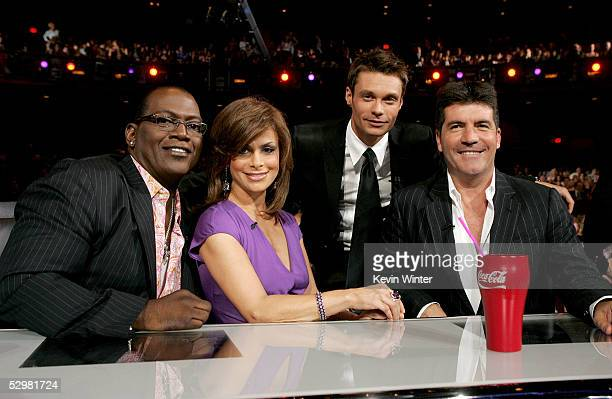 American Idol judges Randy Jackson Paula Abdul host Ryan Seacrest and Simon Cowell are seen infront of the stage at the American Idol Finale Results...