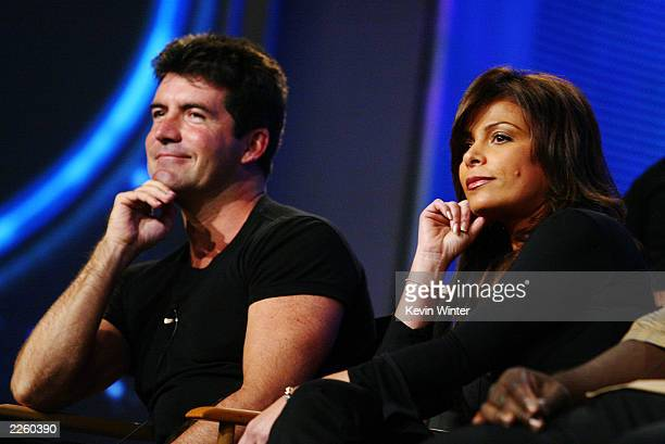 American Idol judges Simon Cowell and Paula Abdul listen to questions from the press at the FOX 2002 SummerTCA Tour at the Huntington Ritz Carlton...
