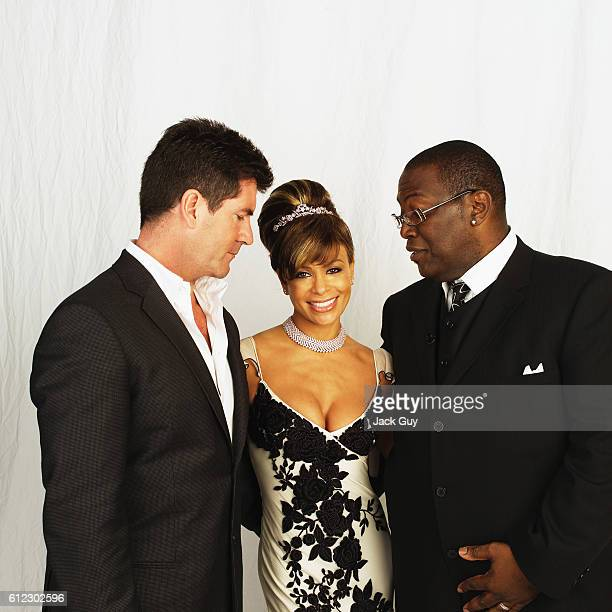 American Idol judges Simon Cowell Paula Abdul and Randy Jackson are photographed for Emmy Magazine at the 55th Annual Emmy Awards on September 21...