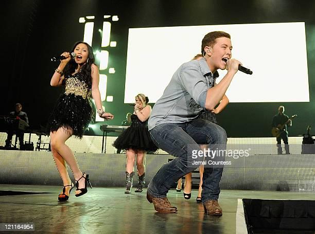 American Idol Season 10 winner Scotty McCreery performs with American Idol Season 10 contestant Thia Megia during the 2011 American Idols Live tour...