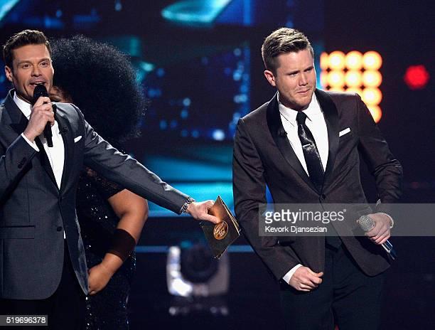 American Idol Season 15 winner Trent Harmon and host Ryan Seacrest speak onstage during FOX's 'American Idol' Finale For The Farewell Season at Dolby...