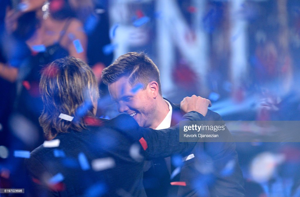American Idol Season 15 winner Trent Harmon celebrates with recording artist Keith Urban onstage during FOX's 'American Idol' Finale For The Farewell Season at Dolby Theatre on April 7, 2016 in Hollywood, California. at Dolby Theatre on April 7, 2016 in Hollywood, California.