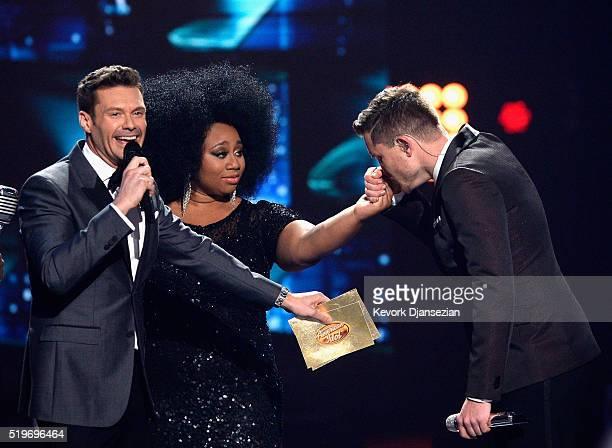 "American Idol Season 15 winner Trent Harmon , host Ryan Seacrest and finalist La'Porsha Renae speak onstage during FOX's ""American Idol"" Finale For..."