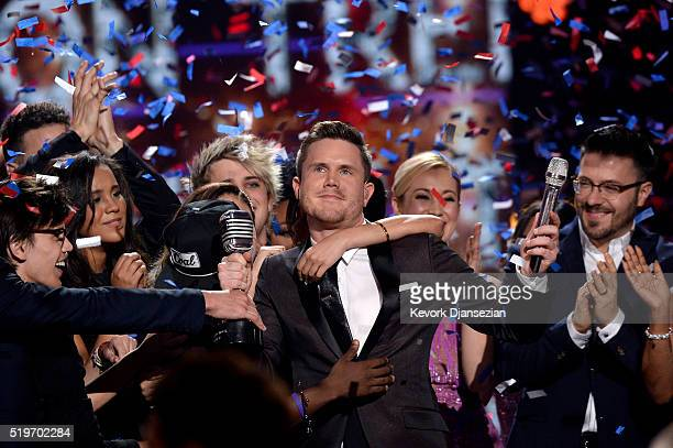 American Idol Season 15 winner Trent Harmon performs coronation song with Season 15 cast onstage during FOX's 'American Idol' Finale For The Farewell...