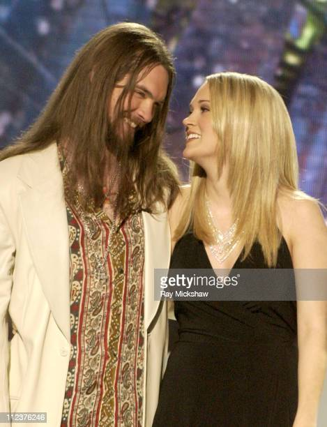 American Idol Season 4 Top 2 Finalist Bo Bice from Helena Alabama and Carrie Underwood from Checotah Oklahoma with Ryan Seacrest
